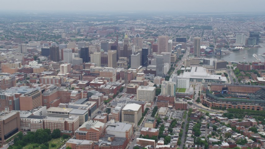5K aerial video approaching Downtown Baltimore, the Baltimore Convention Center, and Oriole Park, Maryland Aerial Stock Footage | AX78_086