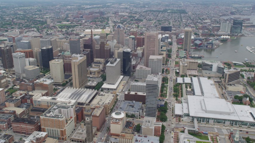 5K aerial video approaching Downtown Baltimore skyscrapers by the Baltimore Convention Center in Maryland Aerial Stock Footage | AX78_087