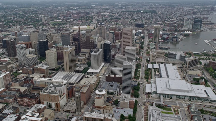 5K stock footage aerial video approaching Downtown Baltimore skyscrapers by the Baltimore Convention Center in Maryland Aerial Stock Footage | AX78_087E