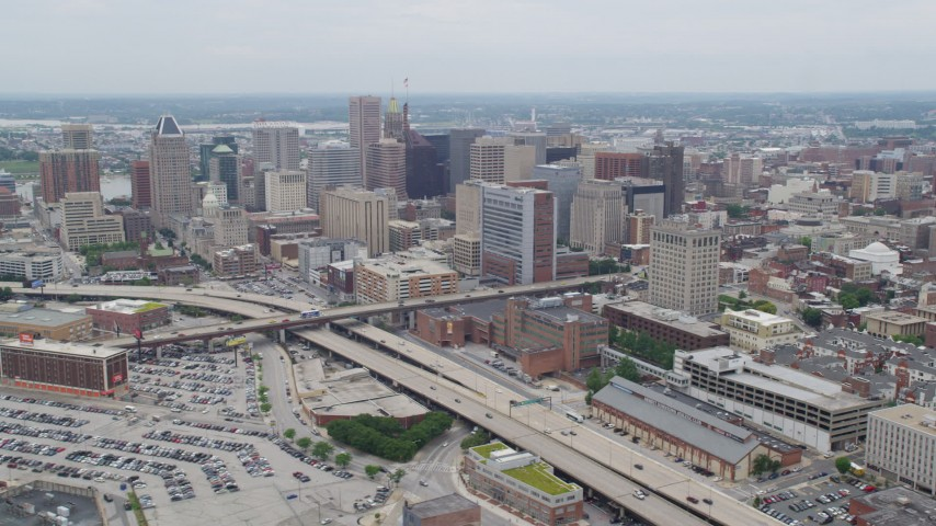 5K aerial video flying by I-83 and Downtown Baltimore skyscrapers, Maryland Aerial Stock Footage | AX78_094