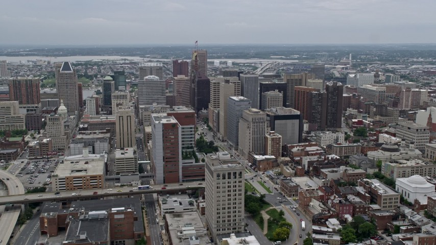 5K stock footage aerial video flying by I-83 and Downtown Baltimore skyscrapers, Maryland Aerial Stock Footage | AX78_094E