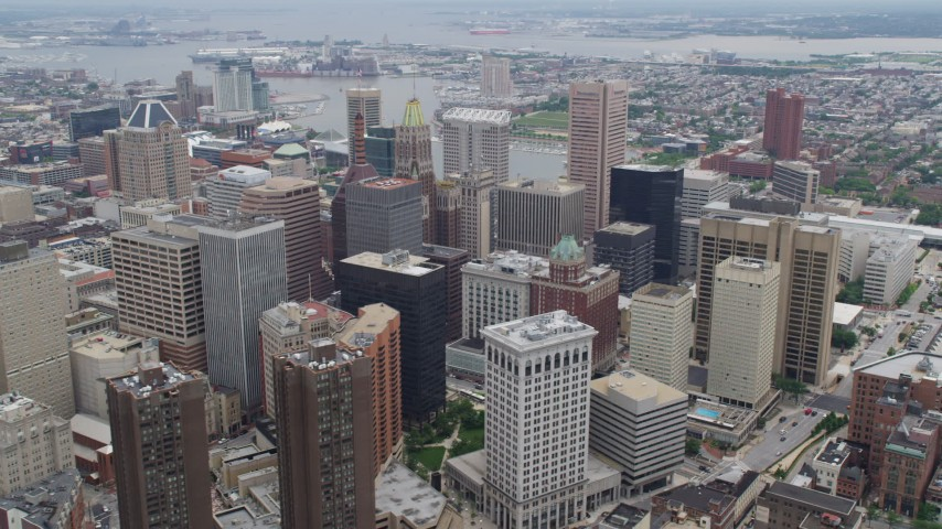 5K stock footage aerial video of Downtown Baltimore skyscrapers, Inner Harbor in the background, Maryland Aerial Stock Footage | AX78_097