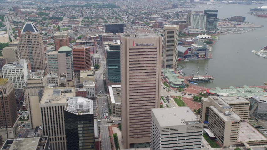 5K stock footage aerial video of Transamerica Tower Baltimore, Inner Harbor area, reveal 100 East Pratt Street, Maryland Aerial Stock Footage | AX78_099