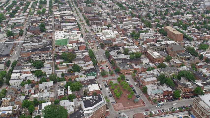 5K stock footage aerial video of shops and apartment buildings around Broadway and Broadway Square in Baltimore, Maryland Aerial Stock Footage | AX78_103