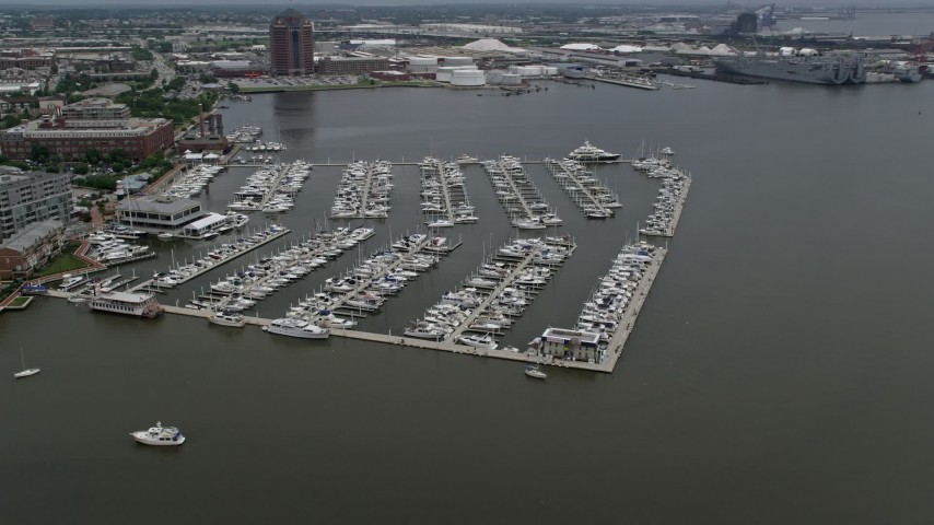 5K stock footage aerial video of boats at the Baltimore Marine Center, Maryland Aerial Stock Footage | AX78_104