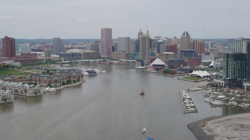 5K aerial video of Downtown Baltimore skyscrapers, Inner Harbor piers, and the National Aquarium, Maryland Aerial Stock Footage | AX78_108