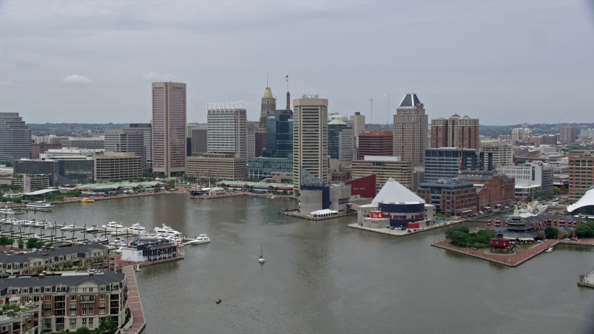 5K stock footage aerial video of Downtown Baltimore skyscrapers, Inner Harbor piers, and the National Aquarium, Maryland Aerial Stock Footage | AX78_108E