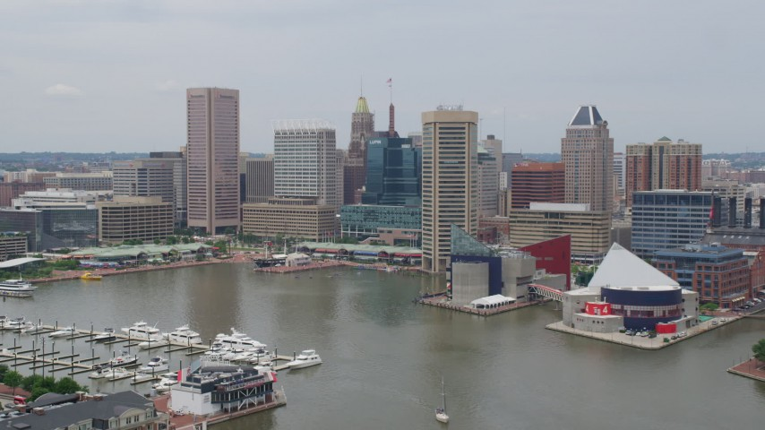 5K aerial video approaching Downtown Baltimore skyscrapers and Harborplace pavilions near National Aquarium, Maryland Aerial Stock Footage | AX78_109
