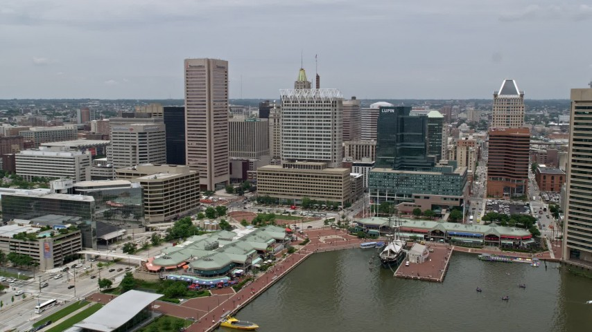 5K stock footage aerial video of Downtown Baltimore skyscrapers, office buildings, and Harborplace waterfront pavilions in Maryland Aerial Stock Footage | AX78_110