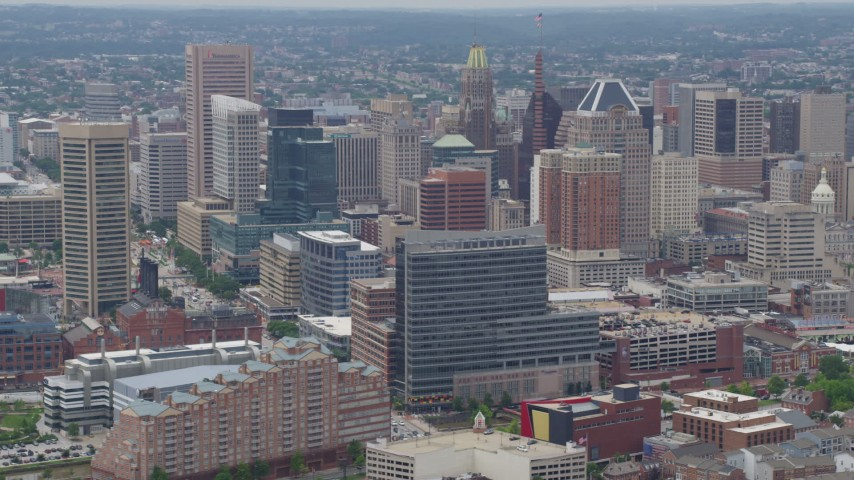 5K aerial video flying by Downtown Baltimore skyscrapers and city buildings in Maryland Aerial Stock Footage | AX78_115