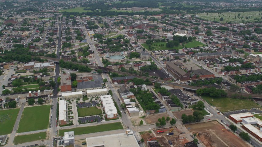 5K aerial video flying over train tracks to approach Israel Baptist Church, Collington Square Park, urban areas, Baltimore, Maryland Aerial Stock Footage | AX78_118
