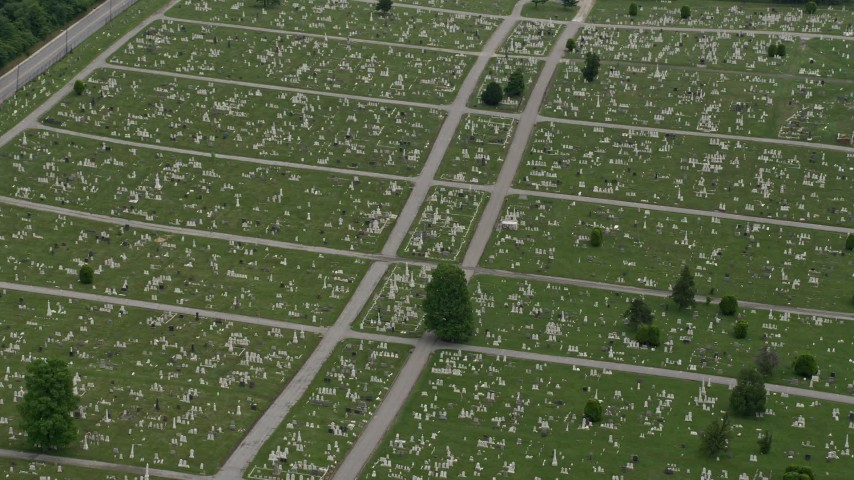 5K stock footage aerial video of gravestones and green lawns at Baltimore Cemetery in Maryland Aerial Stock Footage | AX78_120