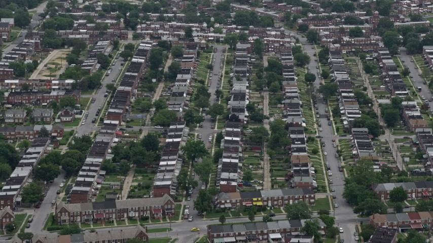 5K aerial video approaching urban row houses in Baltimore, Maryland Aerial Stock Footage | AX78_121