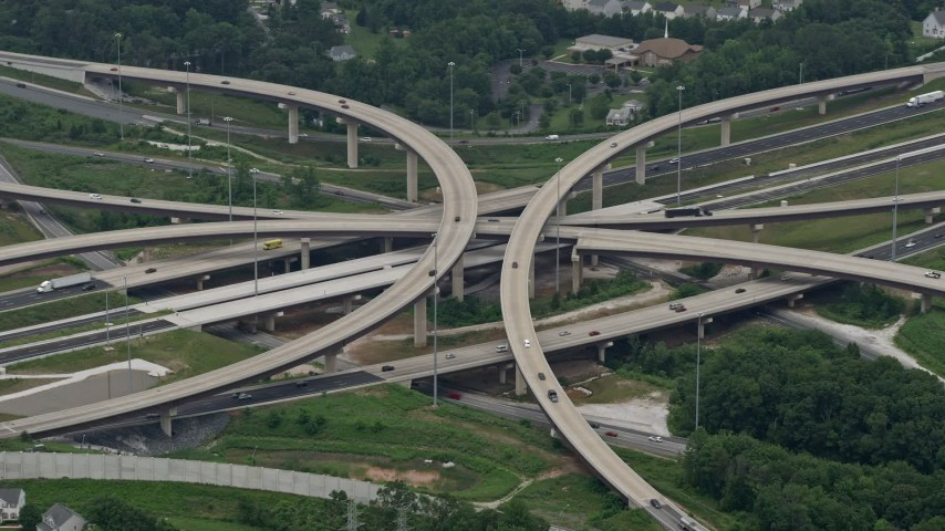 5K stock footage aerial video of light traffic on Interstate 95 and 695 interchange east of the city, Baltimore, Maryland Aerial Stock Footage | AX78_126
