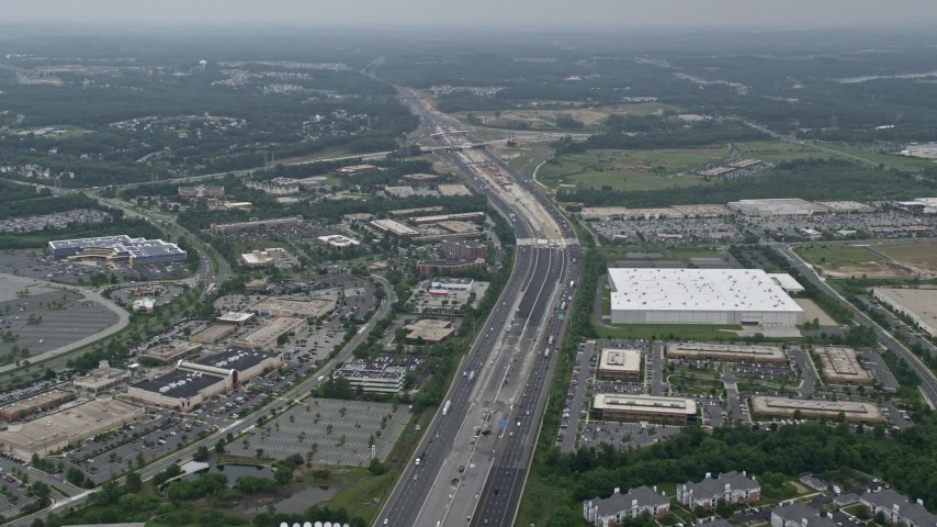 5K stock footage aerial video approaching office buildings, light traffic on Interstate 95, and apartment buildings in Baltimore, Maryland Aerial Stock Footage | AX78_128E