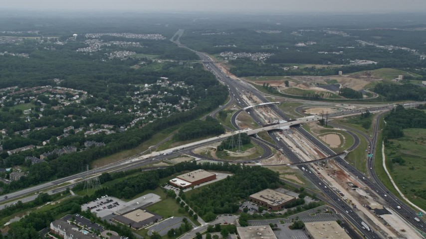 5K stock footage aerial video flying over office buildings by I-95 to approach suburban neighborhoods in Baltimore, Maryland Aerial Stock Footage | AX78_131E