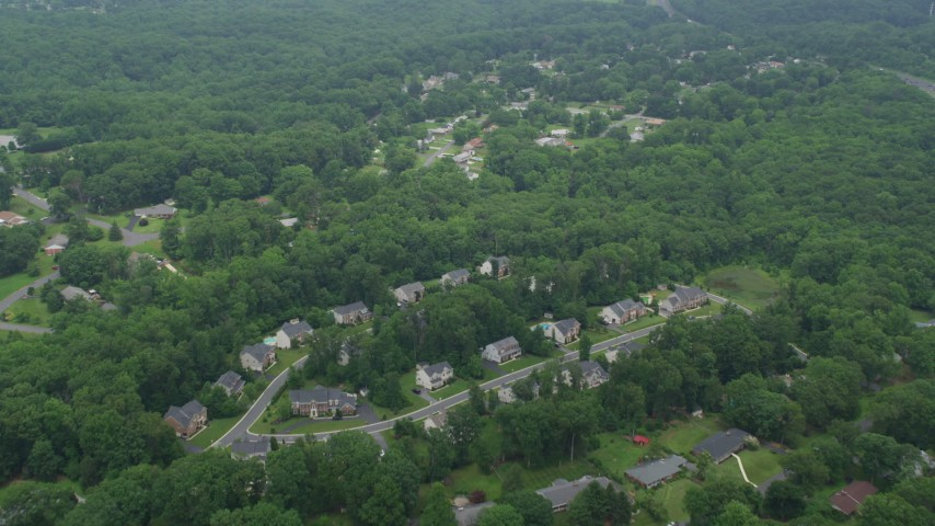 5K aerial video of a small suburban neighborhood and forest in Perry Hall, Maryland Aerial Stock Footage | AX78_134