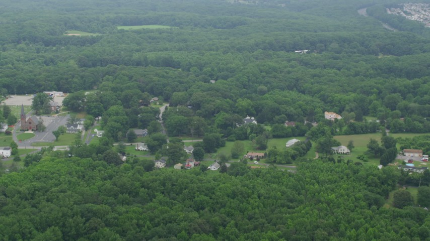 5K stock footage aerial video flying over power lines to approach rural homes and forest in Kingsville, Maryland Aerial Stock Footage | AX78_137