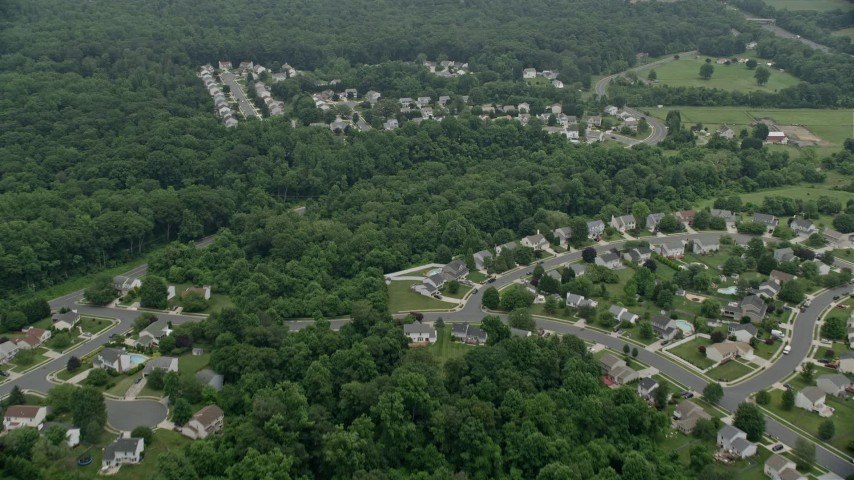 5K aerial video flying over tract homes and trees in Abigdon, Maryland Aerial Stock Footage AX78_145