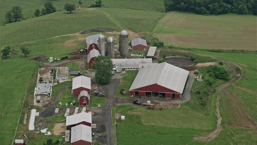5K aerial video of silos and red barns in Abigdon, Maryland Aerial Stock Footage | AX78_146