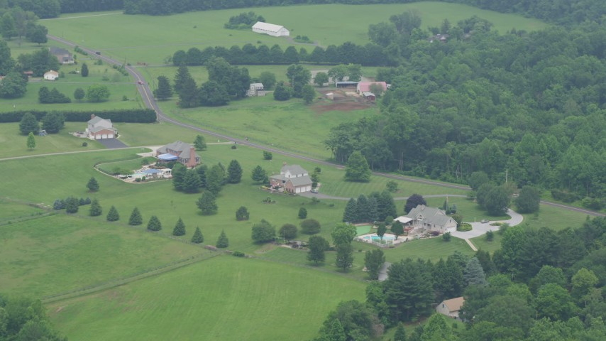 5K aerial video of rural homes and a farm by Cullum Road in Abigdon, Maryland Aerial Stock Footage | AX78_147