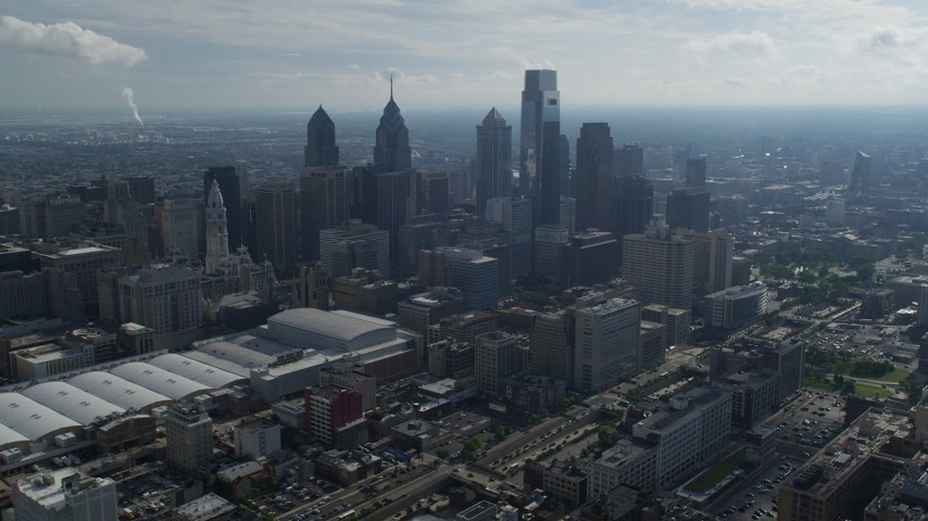 5K stock footage aerial video of Pennsylvania Convention Center and skyscrapers in Downtown Philadelphia, Pennsylvania Aerial Stock Footage | AX79_009