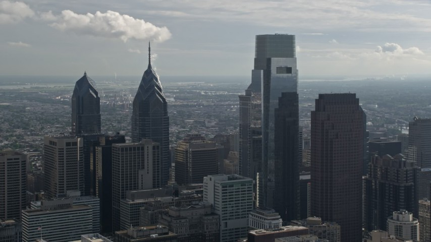 5K stock footage aerial video of One and Two Liberty Place, Comcast Center, Three Logan Square in Downtown Philadelphia, Pennsylvania Aerial Stock Footage | AX79_010
