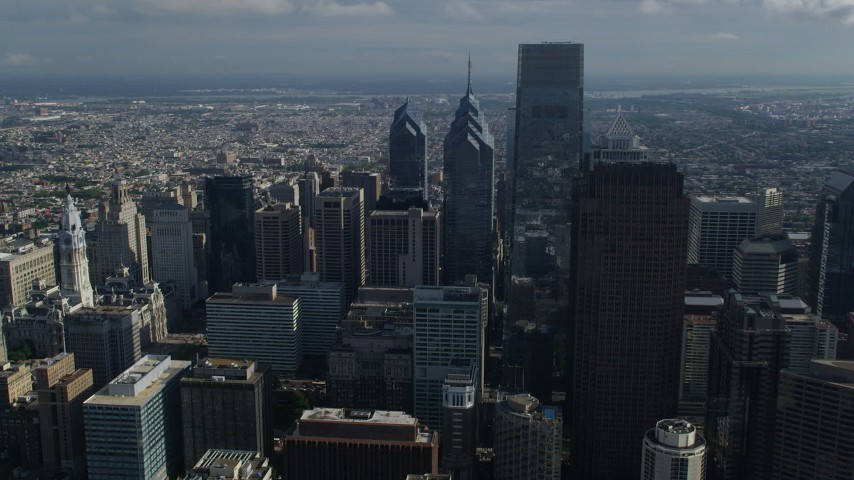 5K stock footage aerial video of Comcast Center towering over Downtown Philadelphia skyscrapers, Pennsylvania Aerial Stock Footage | AX79_012