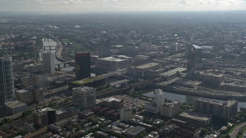 5K stock footage aerial video of 30th Street Station and Main Post Office across the Schuylkill River, Philadelphia, Pennsylvania Aerial Stock Footage | AX79_017