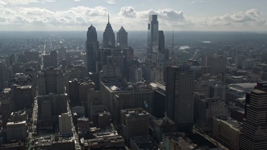5K stock footage aerial video of tall towers and city buildings in Downtown Philadelphia, Pennsylvania Aerial Stock Footage | AX79_022