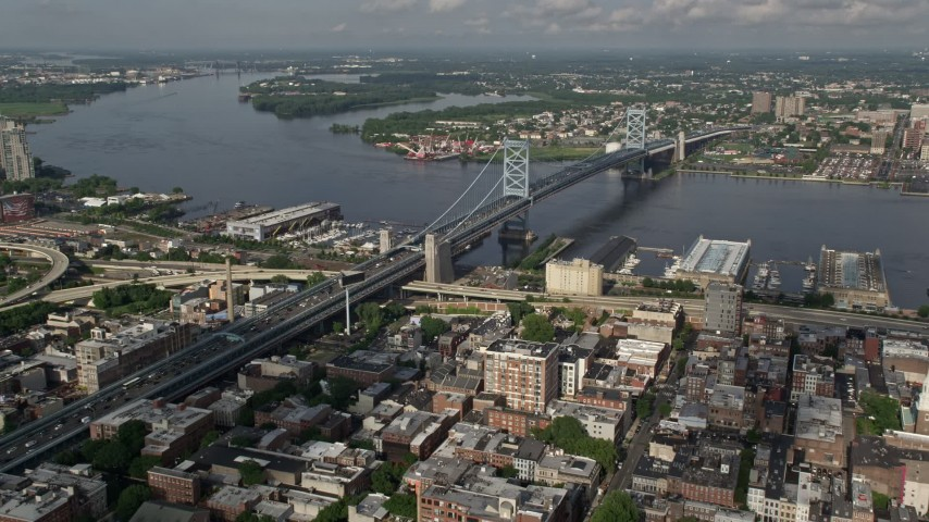 5K aerial video of Benjamin Franklin Bridge spanning the Delaware River between Philadelphia, Pennsylvania and Camden, New Jersey Aerial Stock Footage | AX79_023