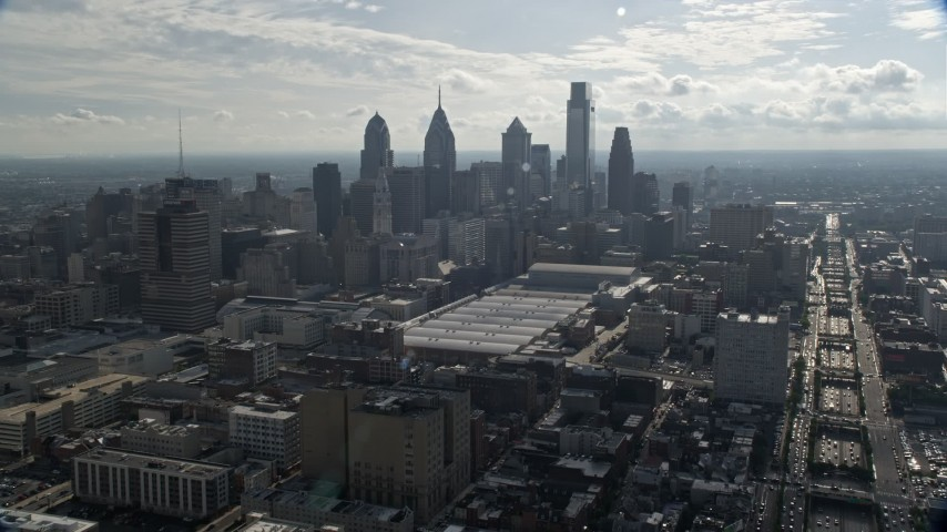 5K stock footage aerial video approaching the Philadelphia Convention Center and the Downtown Philadelphia skyline, Pennsylvania Aerial Stock Footage | AX79_024
