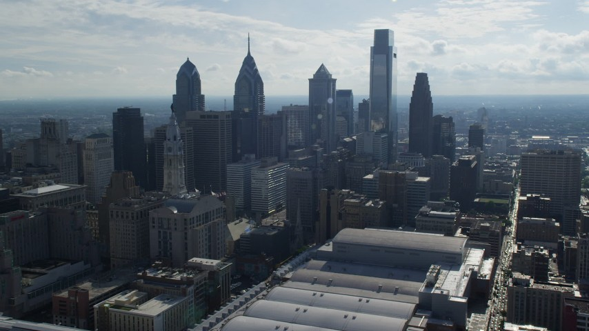 5K aerial video approaching City Hall and tall Downtown Philadelphia skyscrapers, Pennsylvania Aerial Stock Footage | AX79_025