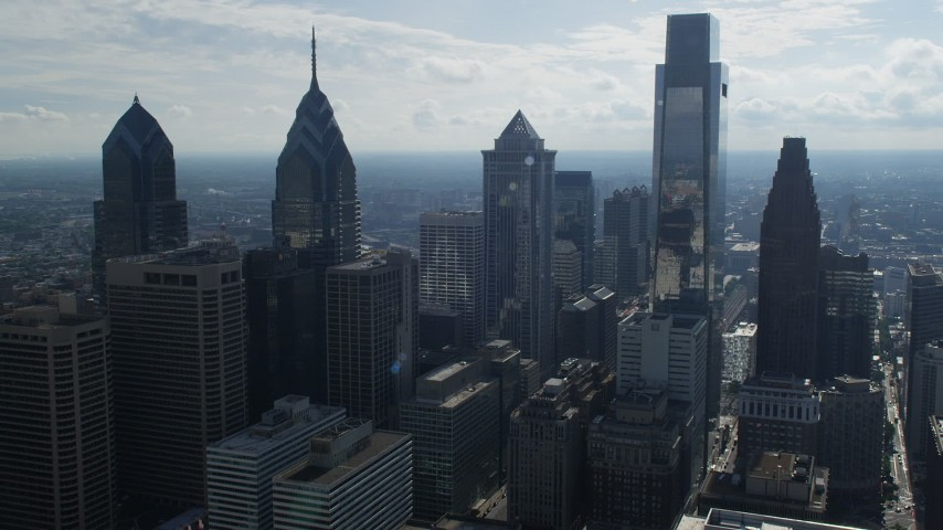 5K stock footage aerial video flying by Downtown Philadelphia skyscrapers to reveal Schuylkill River and West Philadelphia, Pennsylvania Aerial Stock Footage | AX79_026