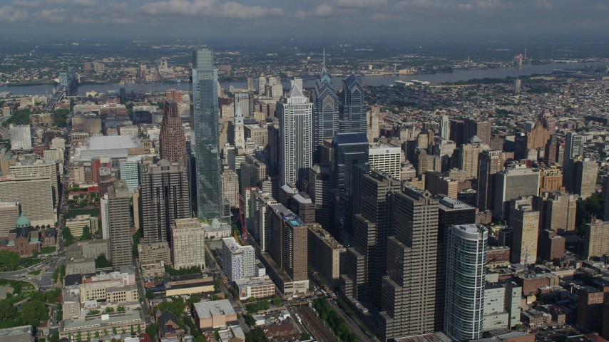 5K stock footage aerial video approaching Comcast Center and BNY Mellon Center towers in downtown Philadelphia, Pennsylvania Aerial Stock Footage | AX79_030