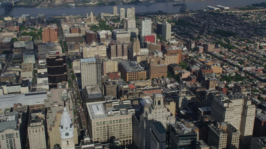 5K stock footage aerial video flying over buildings toward apartment complexes, Delaware River, Downtown Philadelphia, Pennsylvania Aerial Stock Footage | AX79_032