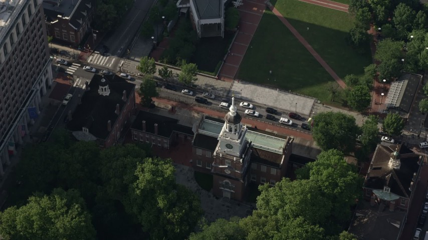 5K stock footage aerial video tilting to a bird's eye view of Independence Hall and Chestnut Street, Philadelphia, Pennsylvania Aerial Stock Footage | AX79_034