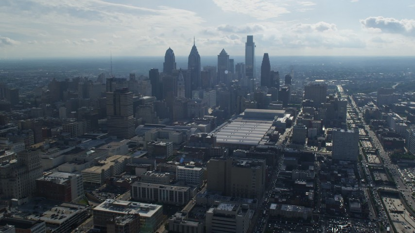5K aerial video flying by the convention center and tall skyscrapers in Downtown Philadelphia, Pennsylvania Aerial Stock Footage | AX79_036