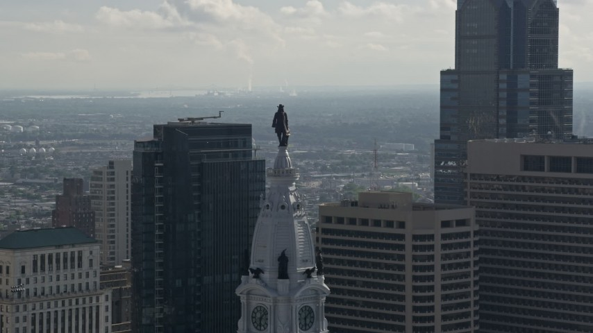 5K stock footage aerial video approaching William Penn statue on Philadelphia City Hall, Downtown Philadelphia, Pennsylvania Aerial Stock Footage | AX79_038