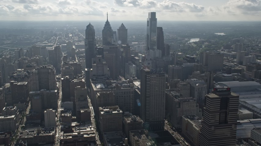 5K stock footage aerial video of skyscrapers behind City Hall, seen from the convention center in Downtown Philadelphia, Pennsylvania Aerial Stock Footage | AX79_042
