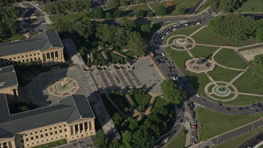 5K stock footage aerial video orbiting Philadelphia Museum of Art and Washington Monument Fountain in Pennsylvania Aerial Stock Footage | AX79_052