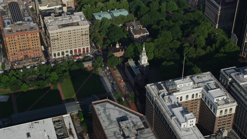 5K aerial video approaching Independence Hall and park in Downtown Philadelphia, Pennsylvania Aerial Stock Footage | AX79_056