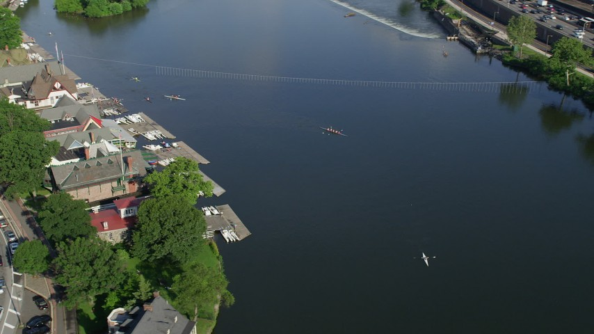 5K stock footage aerial video of rowers on the Schuylkill River by Boathouse Row, Philadelphia, Pennsylvania Aerial Stock Footage | AX79_063