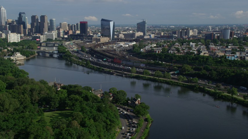 5K stock footage aerial video of Philadelphia Museum of Art and Downtown Philadelphia skyline seen from the Schuylkill River, Pennsylvania Aerial Stock Footage | AX79_066