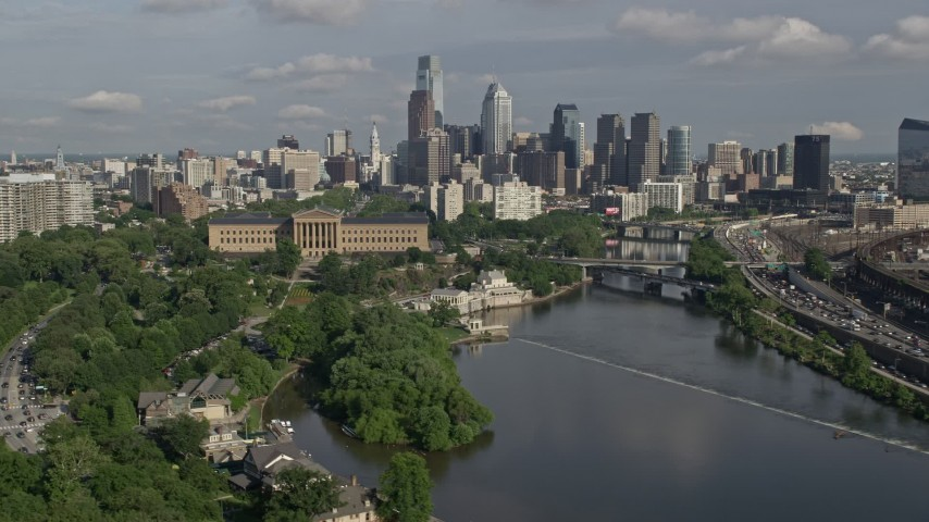 5K stock footage aerial video of Philadelphia Museum of Art and Downtown Philadelphia skyline seen from the Schuylkill River, Pennsylvania Aerial Stock Footage   AX79_066E
