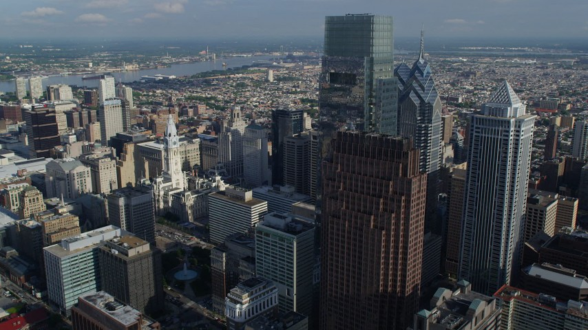 5K aerial video flying by Comcast Center to approach Philadelphia City Hall, Pennsylvania Aerial Stock Footage | AX79_071