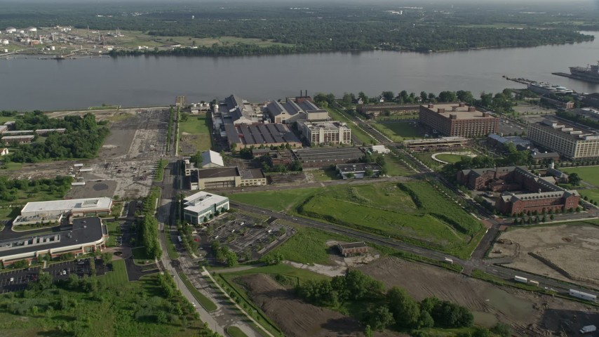 5K stock footage aerial video of factory buildings at The Navy Yard by the Delaware River, Pennsylvania Aerial Stock Footage | AX79_080
