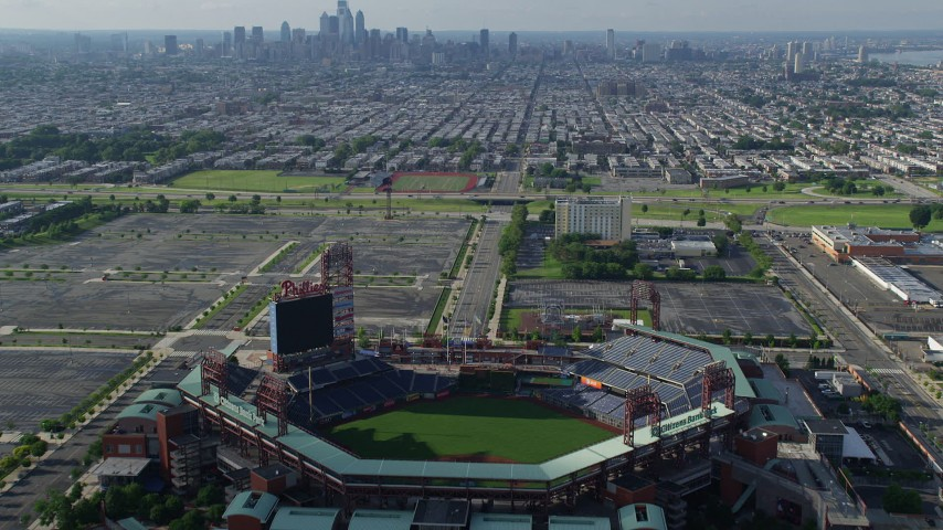 5K aerial video flying over Citizens Bank Park to approach South Philly urban neighborhoods and skyline, Philadelphia, Pennsylvania Aerial Stock Footage AX79_083