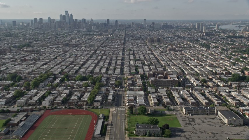 5K stock footage aerial video flying over South Philadelphia neighborhoods with a view of the downtown skyline, Pennsylvania Aerial Stock Footage AX79_084 | Axiom Images