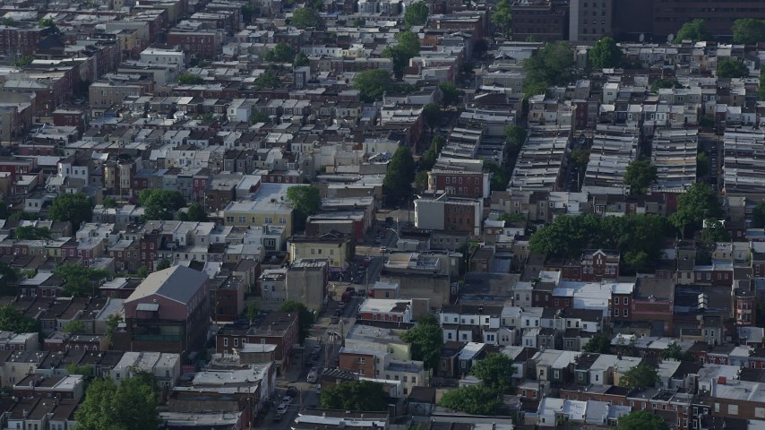 5K stock footage aerial video of urban neighborhood and busy street in South Philadelphia, Pennsylvania Aerial Stock Footage | AX79_086